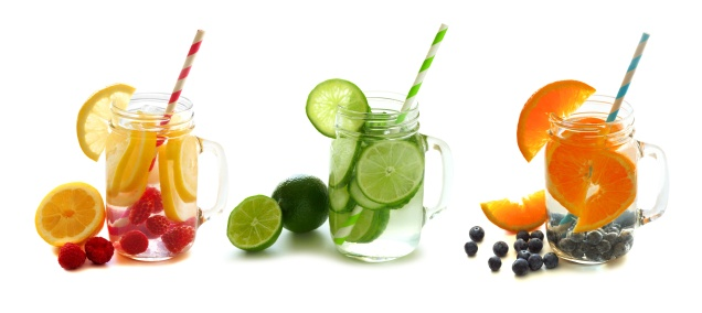 Healthy detox water with fruit in mason jars isolated