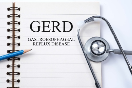 Stethoscope on notebook and pencil with GERD (Gastroesophageal R